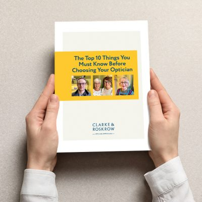 Woman holding book with blank cover on light background. Mock up